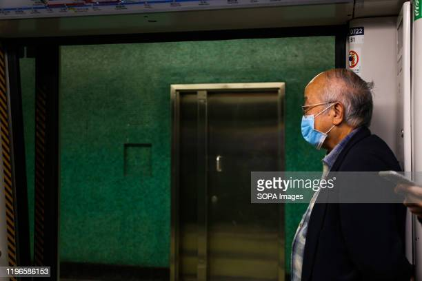 A man wears a face mask on the MTR subway in Hong Kong following reports of the Wuhan Coronavirus in Hong Kong The Wuhan Coronavirus is a new and...