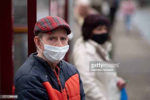 A man wears a face mask while waiting for a bus on September 8 2020 in Caerphilly Wales The county borough of Caerphilly in South Wales is to be...