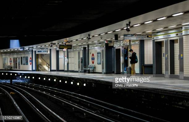 A man wears a face mask whilst waiting for a train at Victoria underground train station on April 17 2020 in London United Kingdom Mayor of London...