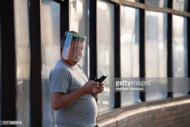 Man wears a face visor in a bus station in the town centre on September 9, 2020 in Merthyr Tydfil, Wales. In the past week 6% of coronavirus tests in...