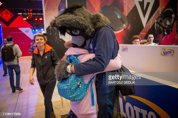 TOPSHOT A man wears a furry costume as he hugs a person during the Intel Extreme Masters Katowice 2019 event in Katowice on March 2 2019