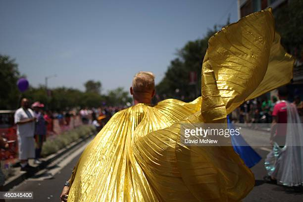 A man wears a golden cape in the LA Pride Parade on June 8 2014 in West Hollywood California The LA Pride Parade and weekend events this year are...