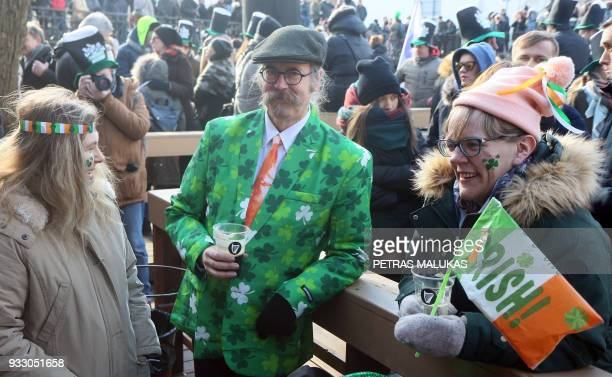 A man wears a green suit to celebrate the Irish festivity Saint Patrick's Day in Vilnius Lithuania on March 17 2018 St Patricks Day occurs annually...