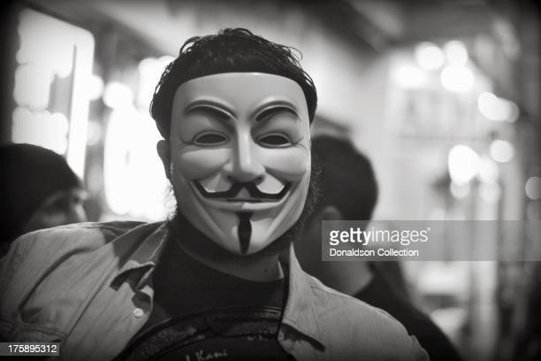 A man wears a Guy Fawkes mask outside the Viper Room night club on August 2 2013 in Los Angeles California