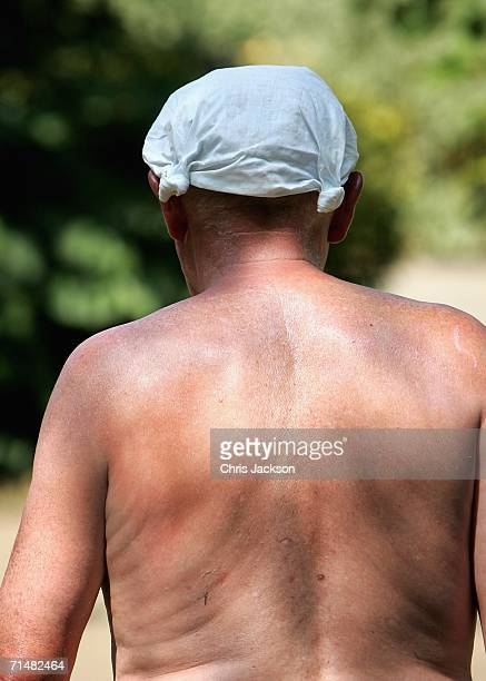 A man wears a handkerchief on his head to protect it from the sun in Battersea park on July 19 2006 in London England Today is expected to become the...