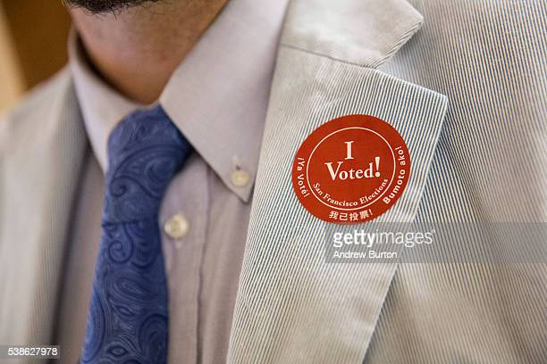 A man wears a I Voted sticker after voting in the California primary on June 7 2016 at City Hall in San Francisco California Six states including...