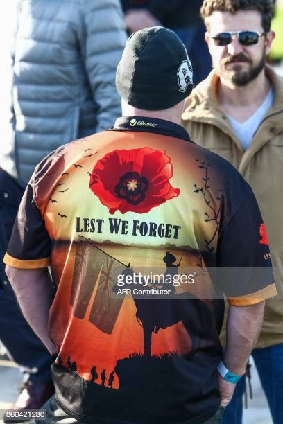 A man wears a jersey showing New Zealand's flag and remembering the dead with the expression 'Lest We Forget' during the commemoration of the WWI...