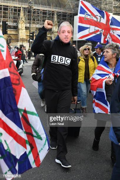Man wears a John Bercow mask as Pro-Brexit activists hold flags and banners outside the Houses of Parliament on what would have been the day that the...