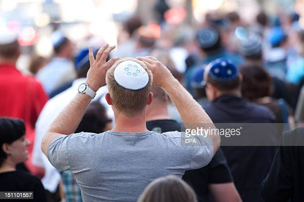 A man wears a kippah the traditional Jewish headgear as he takes part in a kippahflashmob on September 1 2012 in Berlin The flashmob was staged in...