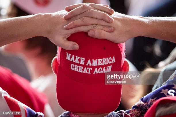 A man wears a 'Make America Great Again' hat as he waits for US President Donald Trump to arrive for a 'Make America Great Again' campaign rally at...