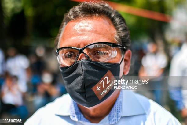 "Man wears a mask as an ""anti-monument"" to mark the 10th anniversary of the San Fernando Massacre in which 72 migrants on route to the United States..."