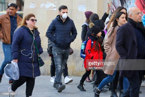 A man wears a mask in center of Baku on February 24 2020 in Baku Azerbaijan Due to the situation in Iran due to the coronavirus Azerbaijan has...