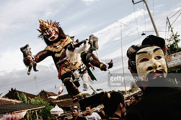 Man wears a mask in the back of his head during Ogoh-ogohs parade on March 11, 2013 in Tunjuk Village, Tabanan, Bali, Indonesia. For the Balinese,...