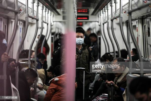 A man wears a mask on the subway on January 22 2020 in Wuhan Hubei province China A new infectious coronavirus known as 2019nCoV was discovered in...