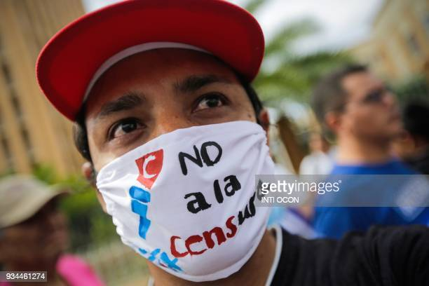 A man wears a mask reading 'No to Censorship' during a demonstration against the possible regulation of social media in front of the National...
