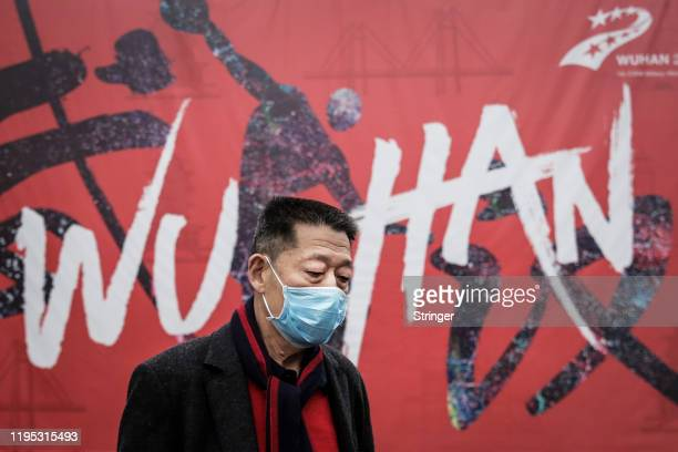 A man wears a mask while walking in the street on January 22 2020 in Wuhan Hubei province China A new infectious coronavirus known as 2019nCoV was...