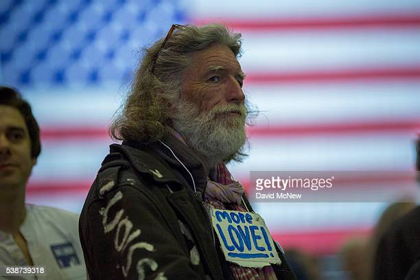 A man wears a message of greater love at the California primary election night rally for Democratic presidential candidate Senator Bernie Sanders on...