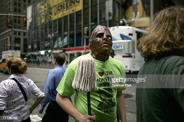A man wears a monster mask in Times Square June 6 2006 in New York City According to the Bible's Book of Revelation 666 is the mark of the beast...