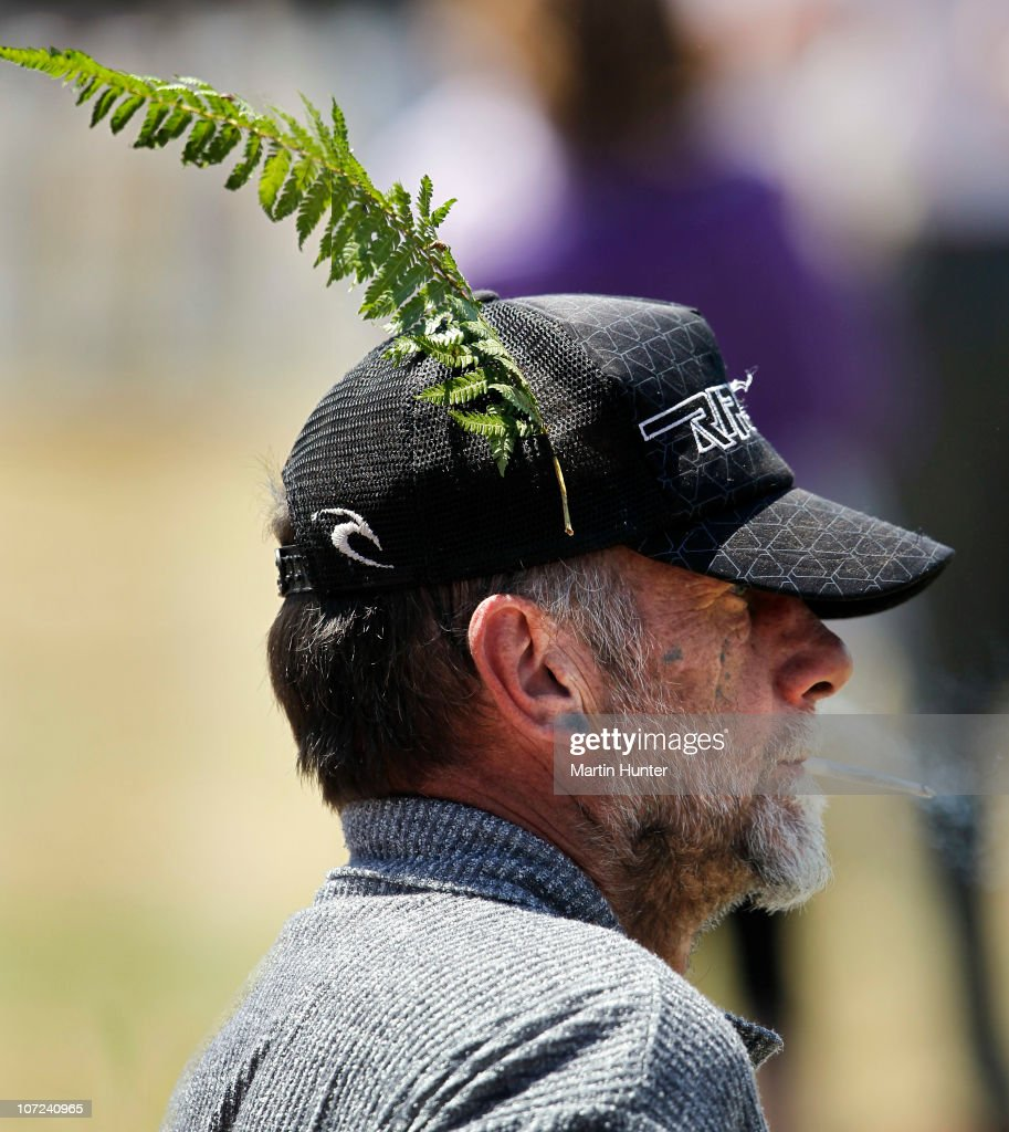 A man wears a native fern on his hat during a national memorial service for the 29 miners that lost their lives in the Pike River Mine at Omoto Racecourse on December 2, 2010 in Greymouth, New Zealand. Two Australians, two Britons, and a South African were amongst the 29 New Zealand mine crew that lost their lives following two blasts at the Pike River Mine 50 kilometers north of Greymouth on New Zealand's west coast.