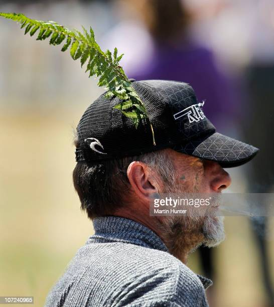 A man wears a native fern on his hat during a national memorial service for the 29 miners that lost their lives in the Pike River Mine at Omoto...