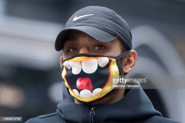 Man wears a novelty face mask on August 4, 2020 in Cardiff, United Kingdom. Coronavirus lockdown measures continue to be eased as the number of...