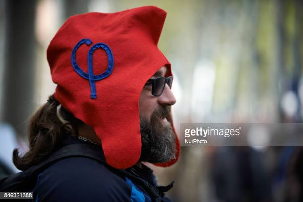 A man wears a phrygian cap symbolizing the movement of JL Mélenchon France Unbowed More than 10000 protesters took to the streets of Toulouse against...