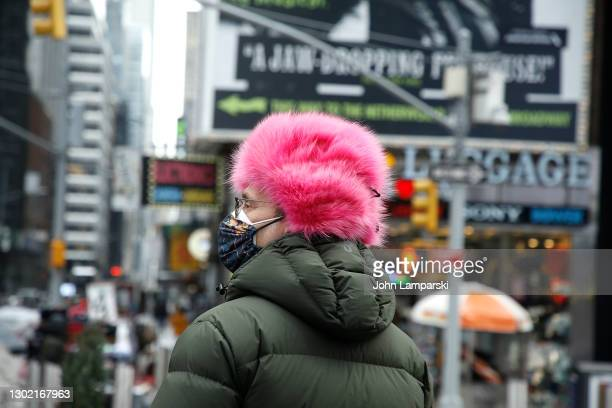 Man wears a pink fur hat in Times Square for Valentine's Day on February 14, 2021 in New York City.