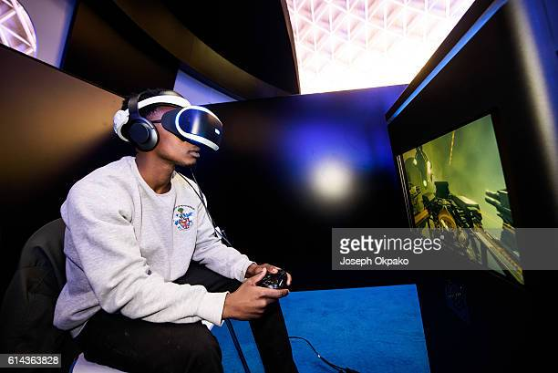 A man wears a PlayStation VR headset developed by Sony Interactive Entertainment LLC to experience a 360degree game in virtual reality during a...