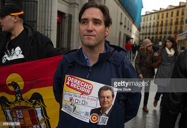 A man wears a poster critical of Catalan leader Arthur Mas during the 39th anniversary of the death of Spanish dictator General Francisco Franco at...