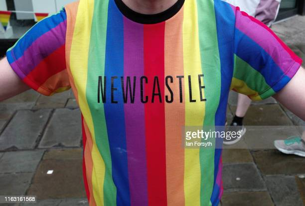 Man wears a pride coloured Newcastle t-shirt as he takes part in the Newcastle Pride Festival parade on July 20, 2019 in Newcastle upon Tyne,...