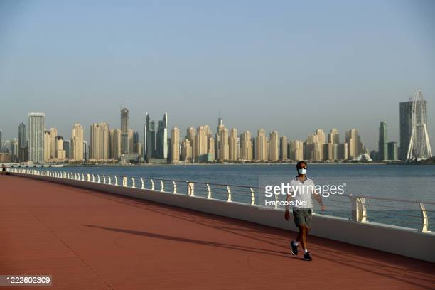 Man wears a protective mask as he exercises on May 03, 2020 in Dubai, United Arab Emirates. The Coronavirus pandemic has spread to many countries...