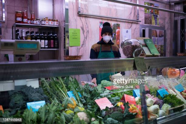 A man wears a protective mask in a vegetable shop on the central market of Turin on November 24 2020 in Turin Italy While the whole country is in...