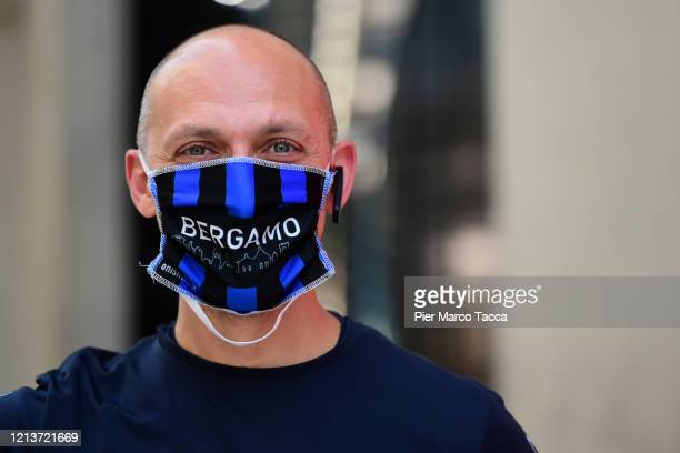 Man wears a protective mask with the writing 'Bergamo' on May 18, 2020 in Milan, Italy. Restaurants, bars, cafes, hairdressers and other shops have...
