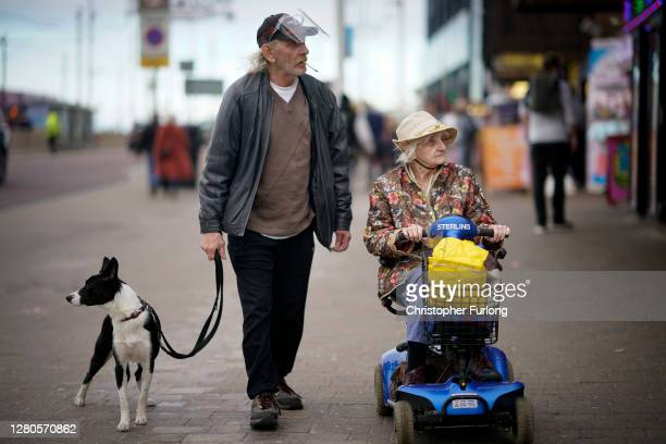 Man wears a safety visor against Covid-19 on the promenade on October 16, 2020 in Blackpool, England. The Lancashire region will go into Tier 3 of...