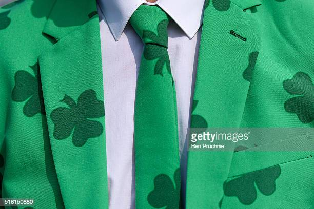 A man wears a shamrock covered suit during St Patrick's Day at the Cheltenham Festival at Cheltenham Racecourse on March 17 2016 in Cheltenham...