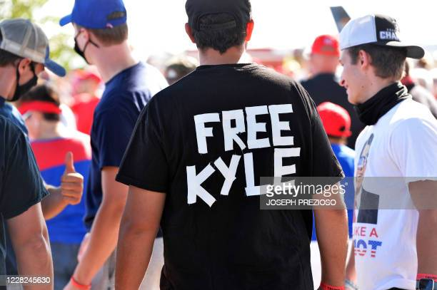 Man wears a shirt calling for freedom for Kyle Rittenhouse the man who allegedly shot protesters in Wisconsin, during a US President Donald Trump...