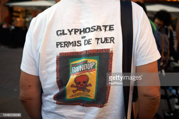 A man wears a shirt reading 'Glyphosate= license to kill 'An association called quotNous voulons des coquelicots' launched a petition and a call to...