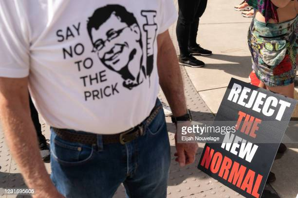 Man wears a shirt referencing Bill Gates and the COVID-19 vaccine at a protest against masks, vaccines, and vaccine passports outside the...