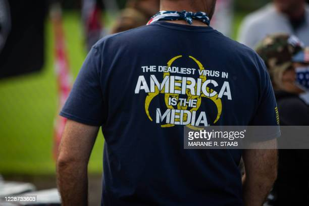 Man wears a shirt with anti-media sentiments during a Proud Boys rally at Delta Park in Portland, Oregon on September 26, 2020. - Far-right group...