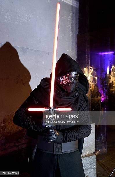 A man wears a Star Wars character Kylo Ren outfit during a party in downtown Rome on December 15 2015 on the eve of the premiere of the Disney movie...