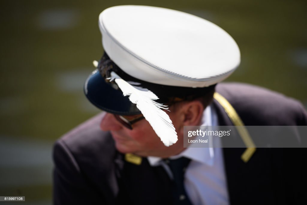 A man wears a swan feather in his cap during the annual Swan Upping census on July 17, 2017 on the River Thames, South West London. The historic Swan Upping ceremony dates back to the 12th century, to when the Crown claimed ownership of all Mute Swans and they were eaten at banquets and feasts. The Sovereign's Swan Marker, David Barber, counts the number of young cygnets on the river each year and ensures that the swan population is maintained. The swans and young cygnets are also assessed for any signs of injury or disease.
