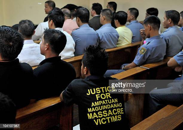 A man wears a Tshirt with the inscription Justice for the Ampatuan Maguindanao Massacre Victims as he attends the trial of a political clan accused...