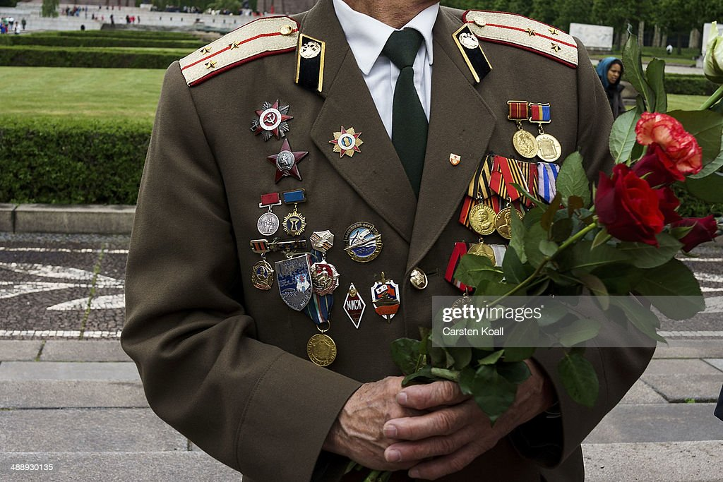 A man wears a uniform displaying badges, medals, badge of honor, awards to commemorate Victory Day, when Nazi Germany surrendered to the Soviet Union on May 9, 1945, at the Soviet war cemetery and memorial in Treptow Park on May 9, 2014 in Berlin, Germany. The annual gathering at the memorial usually draws a mix of leftists and people from the former Soviet Union as well German people.