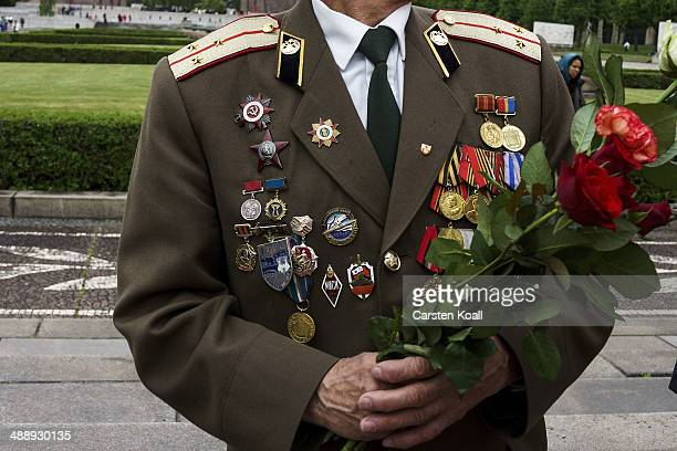 A man wears a uniform displaying badges medals badge of honor awards to commemorate Victory Day when Nazi Germany surrendered to the Soviet Union on...