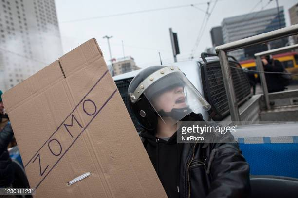 Man wears altered comunist police uniform during We Are Going For Freedom We Are Going For Everything protest organized by Womens Strike and Anti...