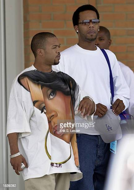 A man wears an airbrushed Tshirt while leaving the public funeral of TLC singer Lisa Left Eye Lopes at the New Birth Missionary Baptist Church May 2...