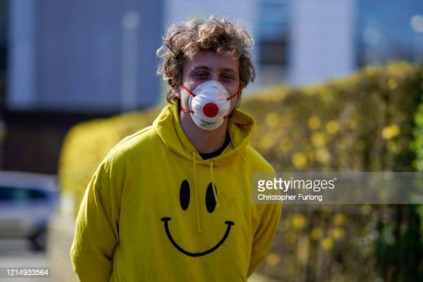 A man wears an an antivirus mask as he walks on the street on March 26 2020 in Manchester England British Prime Minister Boris Johnson announced...
