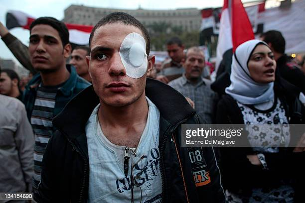 A man wears an eye bandage as protesters gather and shout slogans in Tahrir Square on November 27 2011 in Cairo Egypt Thousands of Egyptians are...