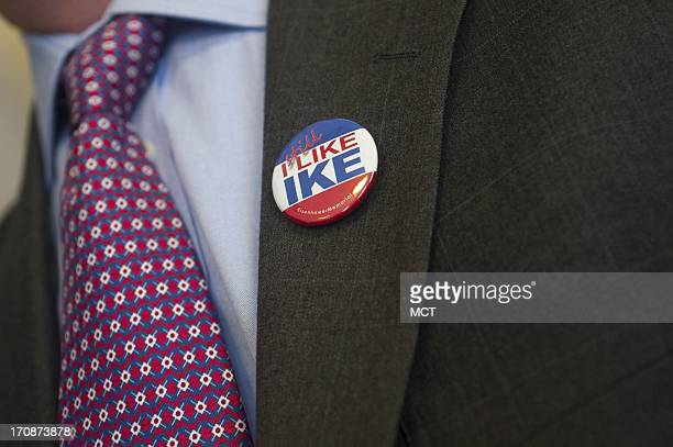 A man wears an I Still Like IKE button during the Eisenhower Memorial Commission meeting regarding proposed changes to the design in Washington DC...