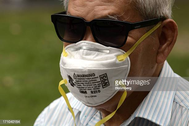 Man wears an N95 face mask in Singapore, on Friday, June 21, 2013. Singapore's smog hit its worst level, blanketing the city-state in thick, smoky...
